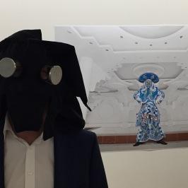 Ben Waymouth wearing Lydia Clark's Mascara Sensorial mask. In front of demian Schopf, La Nave (Ch'uta Mariachi) 2015